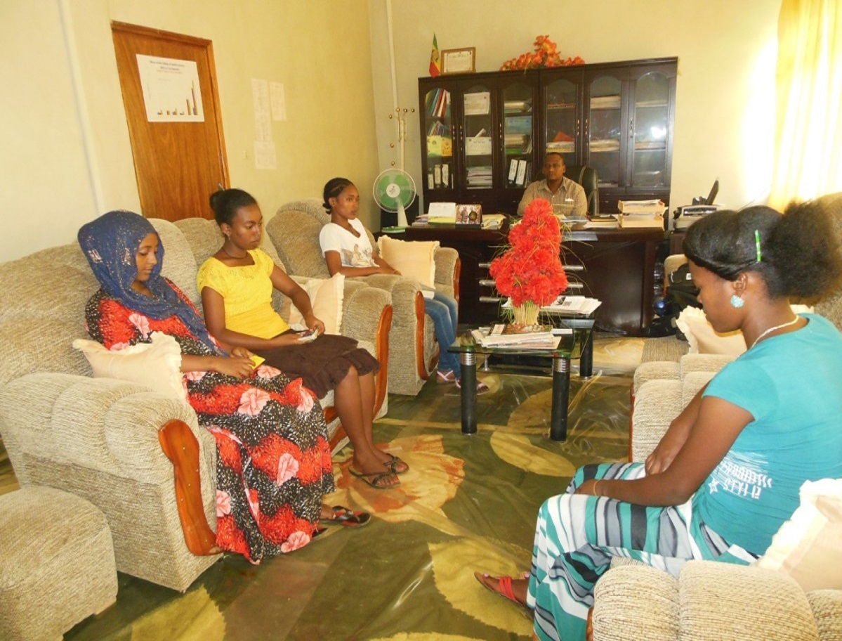 Discussion with new and senior students inside the dean's office (Front center, Mr Addisu G/Mariam, Dean Aman College of Health Sciences, student Elsa Birega Abebe first student next to the right side of Mr Addisu, Student Elshaday Antneh and Jemila Seid on the right side of Elsa are two senior students, and Student Genet Habtamu the other new student), (Picture credit by Adane Sewhunegn)